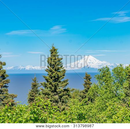 Mount Redoubt, A Volcano, Across Cook Inlet From The Sterling Highway Between Soldotna And Homer, Al