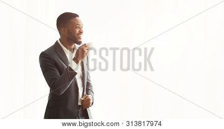 Happy African American Businessman Enjoying Cityview From Window In Office, Panorama With Copy Space