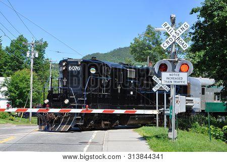 New York State, Usa - Jul. 3, 2010: Adirondack Scenic Railroad Train In Village Of Saranac Lake In A