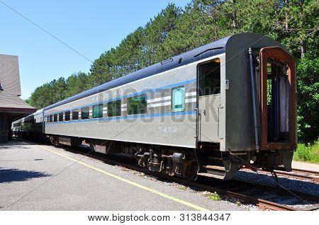 New York State, Usa - Jul. 3, 2010: Adirondack Scenic Railroad Passenger Train At Saranac Lake Stati