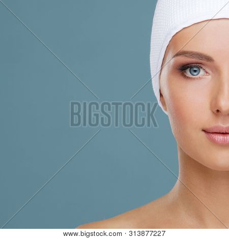 Attractive face of beautiful girl. Close-up portrait of healthy woman. Skin care, cosmetics, makeup, complexion and face lifting. poster