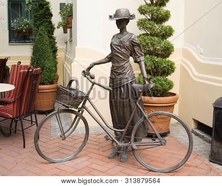 Subotica, Serbia - August 31, 2012: The Sculpture Of A Cyclist Girl In Retro Style In Subotica. Subo