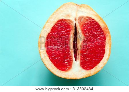 Top View Ripe Juicy Grapefruit  Isolated On A Blue Background
