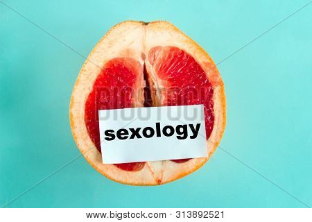 Top View Ripe Juicy Grapefruit  With Note Sexology  Isolated On A Blue Background
