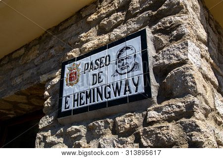 Ronda, Spain - May 30, 2019: Ernest Hemingway Road Sign In The Historic City Centre.
