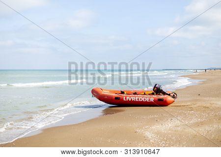 Lokken, Denmark - July 18, 2019: A Lifeguard Rubber Boat At The Sand Beach In Lokken In Northern Jut