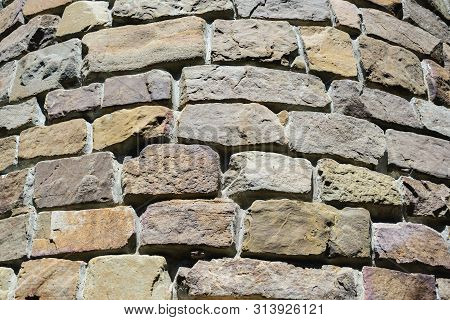 Closeup Of Round Gray Stone Brick Wall Tower, Architectural Construction Background, Horizontal Outd