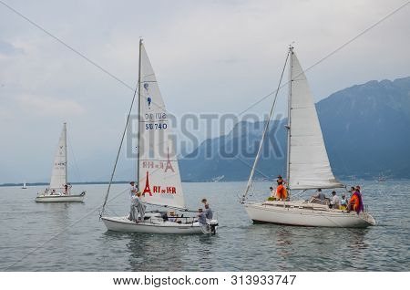 Vevey, Switzerland - July 26 2019: People On Sailboat Celebrate Fete Des Vignerons 2019. Traditional
