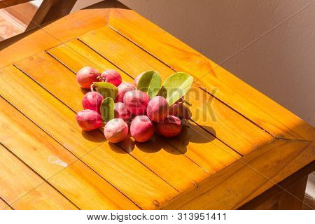 Small Red Fruit On Table. The Top View