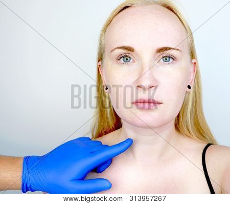 poster of A cosmetologist prepares the patient for surgery: contour plastics of the neck, mesotherapy or botulinum therapy. Wrinkles and creases in the neck, rings of Venus