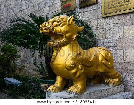 Nanning, China - Nov 1, 2015. Golden Lion At Ancient Temple In Nanning, China. Nanning Is A Large, M