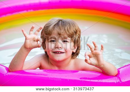 Child Boy And Best Swimming Pool. Child Swimming Pool. Children Fun. Child Water Toys. Cute Kid Rela