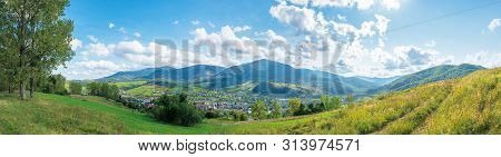 Beautiful Rural Area Of Carpathian Mountains. Trees And Agricultural Fields On Hills. Panoramic Land