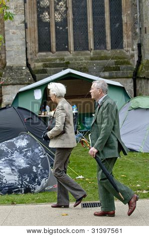 People walking past the Occupy Exeter Camp during the rememberance Day