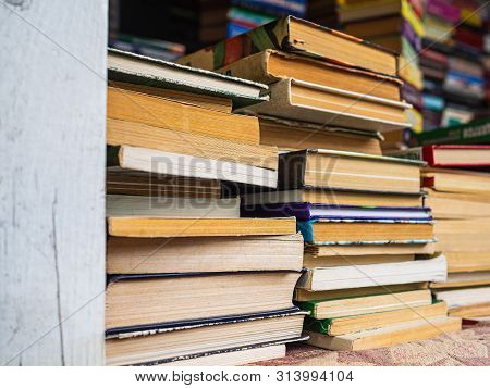 Pile Of Old Books. Dirty Books With Yellowed Pages. Stack Of Books On The Counter. The Day Of The Bi