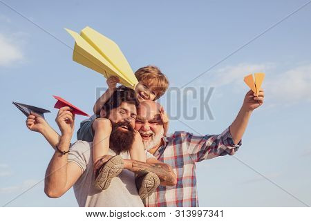 Three Different Generations Ages: Grandfather Father And Child Son Together. Father And Son Enjoying