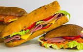 a sandwiches with ham and a fish poster