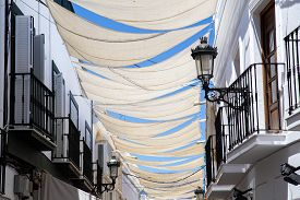 Nerja, Spain - May 28, 2019: White Sun Shade Sails In The Charming Streets Of Nerja.