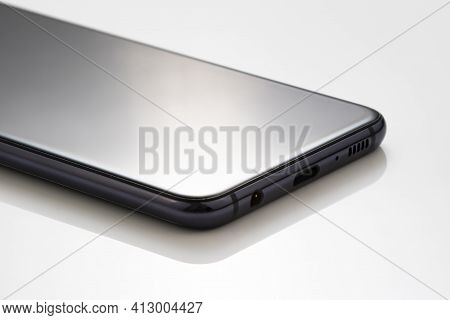 Mobile Cell Phone On White Acrylic Table For Presentation Product Photography. Smartphone Commercial