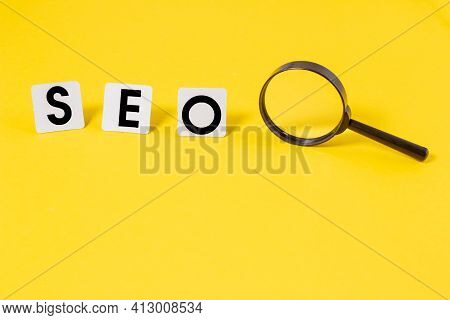 Seo Search Engine Optimization Logo Ranking Concept On A Yellow Background, Seo Is One Of The Online