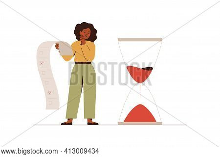 African American Businesswoman Looks At The Hourglasses With Fear And Anxiety. Stressful Black Femal