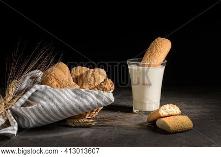 Freshly Baked Homemade Crunchy Cookies Putting Into A Glass Of Milk. A Delicious Treat For Gourmets,