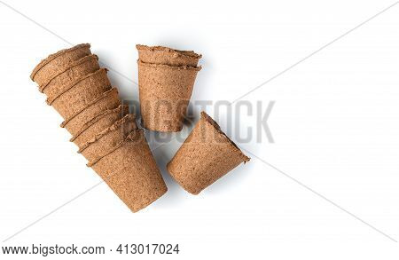 Empty Peat Pots For Seedlings On A White Background. The Concept Of Cultivation.