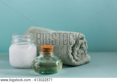 Composition With Natural Organic Coconut Oil Cosmetic Body Lotion On Light Blue Color Background. Na