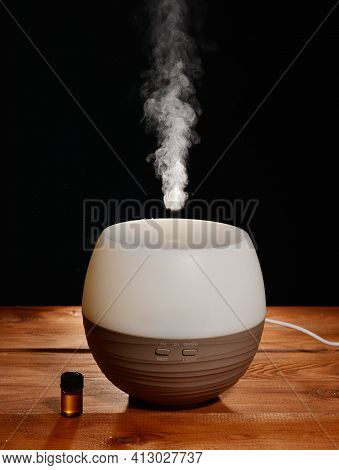 Diffuser For Essential Oils. Steam From A Diffuser With Essential Oils. Health Treatment And Prevent