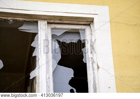 Broken, Smashed Window Glass On An Uninhabited Building In Bavaria, Photographed With The Telephoto