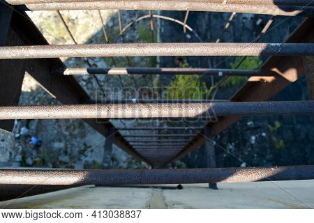 An Old Rusty Staircase To The Roof Of The Building. Abandoned Industrial Object.