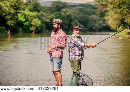Peaceful Activity. Nice Catch. Rod And Tackle. Fisherman Fishing Equipment. Fisherman Grandpa And Ma