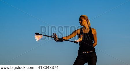 Sexy Woman Fire Performer Manipulate Flaming Baton Evening Blue Sky Outdoors, Twirling