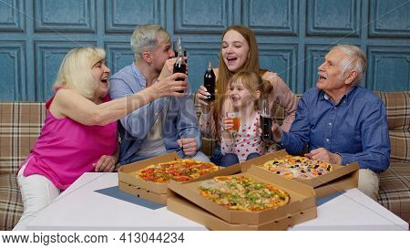 Happy Multigenerational Family Having Lunch Party At Home, Eating Pizza Food, Raising Toast Together