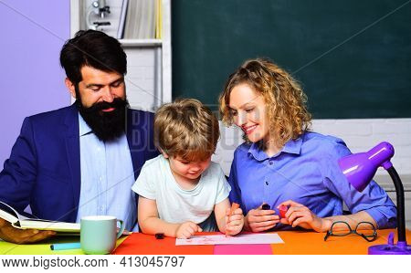 Back To School. Pupil Learning Letters And Numbers. Educational Process. School Family. Little Kid R