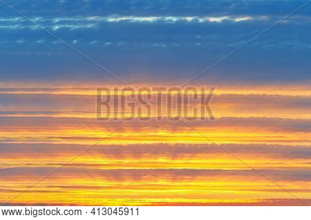Colorful, Unfocused Cloudy Sky Background At Sunset