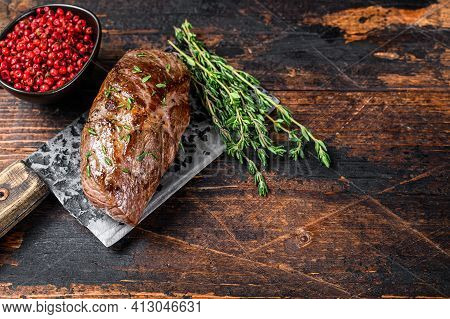 Bbq Grilled Veal Sirloin Meat Steak On A Meat Cleaver With Herbs. Dark Wooden Background. Top View.