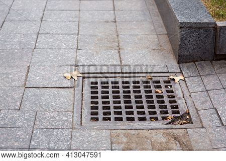 Square Drainage Storm Grate Systems Of City Infrastructure Pedestrian Walkway With Dirty Tile  And G