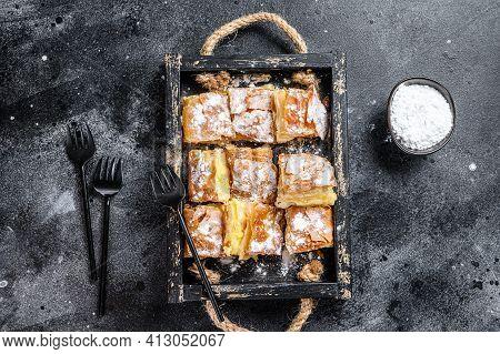 Sliced Bougatsa Pie Pastry With Semolina Custard Cream. Black Background. Top View