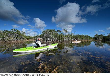 Woman And Active Senior Kayaking On Nine Mile Pond In Everglades National Park.