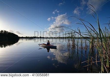Woman Kayaking On Nine Mile Pond In Everglades National Park, Florida.