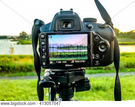 A Beautiful Scenic Landscape Through The Viewfinder Of A Nikon Camera On A Tripod. The Focus Is On T