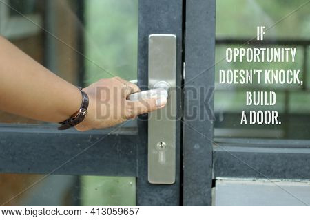 Motivational Words On Door Glass - If Opportunity Does Not Knock, Build A Door. With A Person Holdin