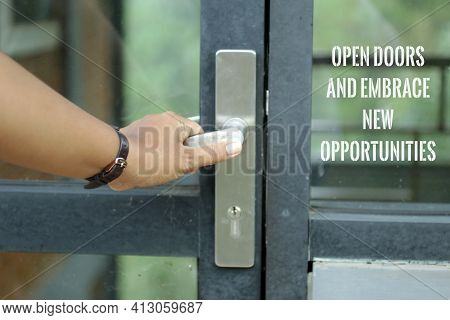 Motivational Words On Door Glass - Open Doors And Embrace New Opportunity. With A Person Holding Doo