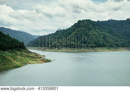 Scenic Mountain Range Next To Deep River Landscape View At Nakhon Nayok, Thailand. Khun Dan Prakan C