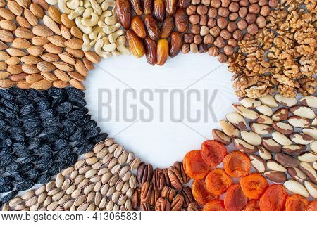 Assorted Nuts Banner From The Center: Dates, Hazelnuts, Walnuts, Brazilian, Dried Apricots, Pecans,