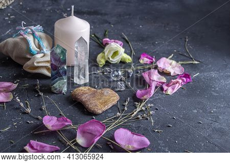 Magic Composition With Pink Candle, Crystals, Pagan Bag And Flowers. Esoteric And Pagan Rituals, Wit