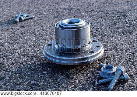 Spare Parts. Auto Motor Mechanic Spare Or Automotive Piece On Dark Road Asphalt Background. Set Of N
