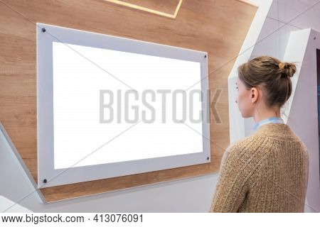 Woman Looking At Blank Digital Interactive White Display Wall At Exhibition Or Museum With Futuristi
