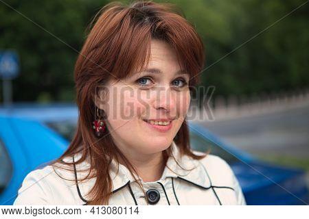 Beautiful Redhead Cheerful Woman Portrait In Nature